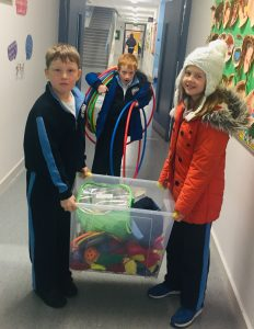 Student council members with selection of toys they organised for the school