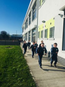 Children in GSR uniform running their 'daily mile'